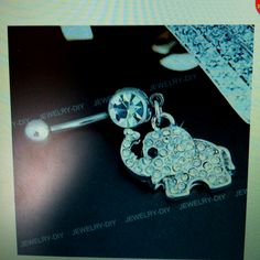 Holy crap, i totally need to get my belly button pierced now!! Elephant <3