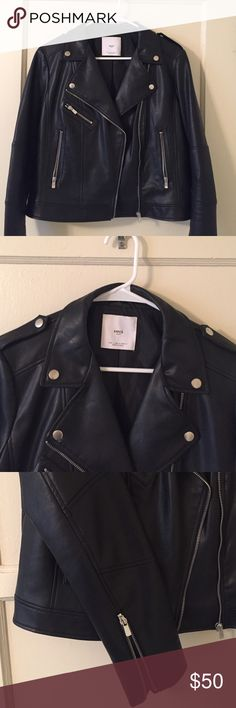 Moto style faux leather jacket MNG by Mango black faux leather jacket with silver accents. LOVE the jacket but I bought it a size bigger to fit over sweaters in the winter and now I want to replace it with something more fitted. Jacket is 100% viscose and the lining is 100% polyester. Mango Jackets & Coats