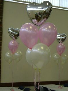 Pretty balloon bouquet with pale pink and white balloons topped with a silver foil heart xx