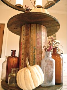 Looks like wooden yardsticks with a cable spool to make an interesting table.