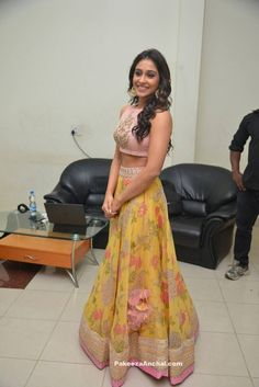 Regina Cassandra In Yellow Floral Lehenga With Pink Embroidery High Neck Net Blouse