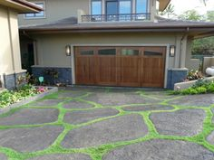 DrivewayPhoto GalleryYour driveway is your welcome mat, the pathway to your home.You can add character to a straight driveway using stampedconcrete.