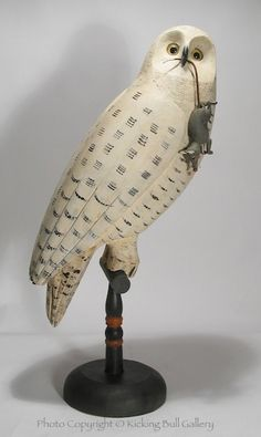 Life sized hollow Snowy Owl with carved vole carved by Jay Miles.  Vole has leather tail which inserts into owl's bill.  Like Kicking Bull Gallery on Facebook for our latest carvings and news.