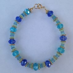 Aqua Mixed Glass Bracelet Aqua glass faceted in 14k gold plated. Very stunning piece. Handmade! New! Cindylou's Design Jewelry Bracelets