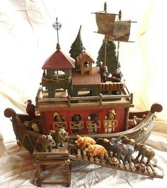 """Made of wood. 25"""" long, 8"""" across and about 17"""" tall ( without the sails ). There is a wooden ramp and a little wooden landing that she had most of the animals and Noah on. There are 11 pairs of animals- zebras, geese, monkeys, turtles, giraffes, sheep, lions, pigs,elephants(She added these herself at the insistance of her grandson:-) and doves. Also has a resin Noah. There are 3 wooden trees that stand on a wooden base , 2 fabric pennant/sails, a little finial for the top."""