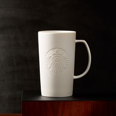 Chase the chill away with warm sips from this modern white coffee mug.