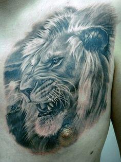 Realistic Lion Head Tattoo On Man Chest