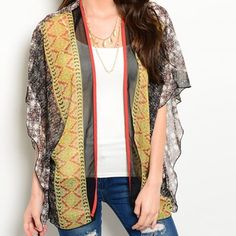 The most fabulous kimono! Stunning colors! Truly beautiful in charcoal- yellow red and pink- this will make any outfit- featuring dolman sleeves and wrap around cut- very flattering! My favorite! Other