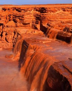 The 185-foot-tall Grand Falls, also known as Chocolate Falls due to its muddy waters, is located in the Painted Desert of Arizona in Navajo Nation outside Flagstaff, Arizona.