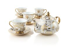 Gold paisley accent makes this tea set perfect.  Now only if it came with a cream and sugar set and a gold plated tray...