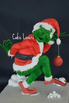 we are late with this cake , but still wanted to share this sculpted cake representing a favourite christmas character. The internal structure took a lot of thinking, planning and elbow greese but at the end we are happy with the outcome . Christmas Themed Cake, Christmas Cakes, Christmas Sweets, Christmas Cooking, Christmas Goodies, Christmas Gingerbread House, Grinch Christmas, Winter Christmas, Grinch Cake
