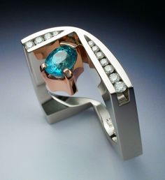 Custom Made White and rose gold ring with blue Zircon and Diamonds
