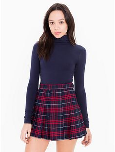 A high-waist mini skirt featuring side button closure and thin pleats in a plaid print.