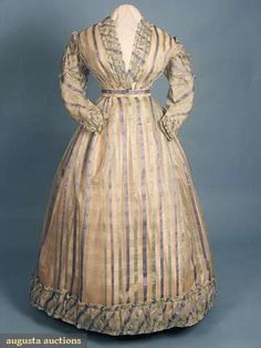 SILK ORGANDY SUMMER GOWN, c. 1865 April 2009 Vintage Fashion and Textile Auction New York City 2-piece white organdy w/ silk brocade vertical stripes in mint green & blue, self fabric ruched band trim, B 34, W 22, Bodice CBL 13, Skirt L 40-53, excellent; t/w 1 white mull dress, printed brown & blue wide morning glory band on skirt, overskirt w/ narrow print band