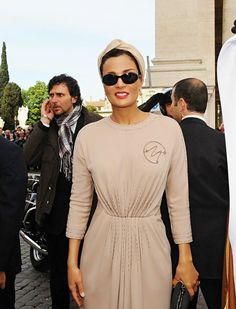 Sheikha Mozah being the center of attention in her gorgeous Dior couture in Rome, Italy. She looks like a Hollywood superstar, notice her initial on the dress.