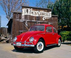 AUT 22 RK1468 04 - 1966 Volkswagen Beetle Red Front 3/4 View On Pavement By Barn - Kimballstock