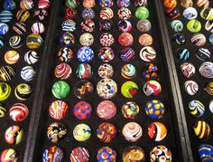 Moon Marble Co., Bonner Springs, KS.  Marbles by Bruce Breslow. I would love to visit this place.