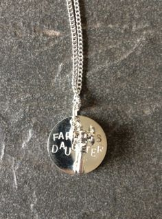 """Farmer's Daughter"" with tractor charm Hand-stamped, silver-plated, 1"" disc charm 16"" chain ""just when I thought it couldn't get no hotter I caught glimpse of the farmer's daughter..."""