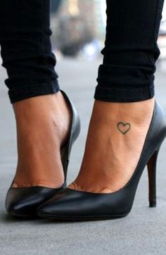little heart tattoo on the foot. Really like because it is simple and Cute!