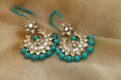 TURQUOISE GOLD CHANDBALA by designer Bubbles Jewellery from sobayha.com. An intricately designed chandbala earring with Kundan and turquoise beads with string support. See more at: https://www.sobayha.com/catalogue/turquoise-gold-chandbala_264/