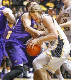 Wichita State's Ron Baker fights for a rebound with Northern Iowa's Matt Bohannon during the first half at Koch Arena Saturday. (Feb. 13, 2016)