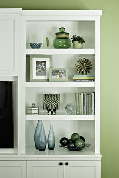 Picture frames, books, collectibles can take over most bookcases consider editing and paring down. Mix favorite items together to lighten up your bookcase. You can also change out during the year for the seasons. Styling Bookshelves, Decorating Bookshelves, Bookshelf Design, Bookshelves Built In, Built Ins, How To Decorate Bookshelves, Bookcase Bed, Book Shelves, Living Room Shelves