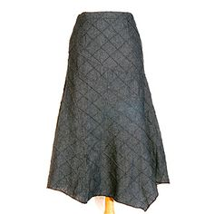 Long denim skirt with flair; crafted in unique panels and handkerchief design.