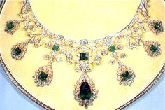 """The exquisitely crafted emerald and diamond encrusted Godman Necklace, which is part of Her Majesty Queen Elizabeth II's personal jewelry collection, was a gift by the two elderly Godman sisters to her majesty the Queen. The name """"Godman Necklace"""" reflects the name of the original owners of the necklace. (description from internetstones.com) Empress Josephine, British Crown Jewels, Royal Crown Jewels, Royal Jewelry, Royal Tiaras, Royal Crowns, Tiaras And Crowns, Elizabeth Ii, Emerald Diamond"""