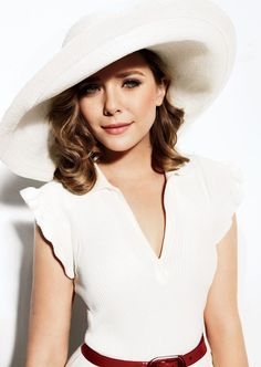 i love big hats.  btw, this is Mary Kate and Ashley Olson's little sister... Elizabeth.