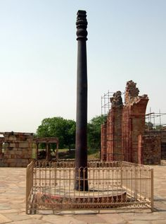 The Iron Pillar of Delhi is a 22 feet high pillar located in the Qutb complex in India. The pillar, made from wrought iron, has been astounding scientists by its ability to resist corrosion after all these years. New Delhi, Delhi India, India India, Iron Pillar Of Delhi, Out Of Place Artifacts, Historical Artifacts, Ancient Artifacts, Historical Monuments, Greatest Mysteries