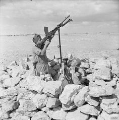 Troops of the Polish Independent Carpathian Rifles Brigade in a Bren machine gun post. Servicemen of the Brigade distinguished themselves during the Siege of Tobruk and earned a nickname of 'the Rats of Tobruk'.