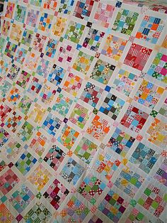 postage stamp quilt - measures 91 x 91 inches, 169 16-patch blocks, + exactly 2900 two-inch squares. It is a lot of piecing (no strip piecing, here!)
