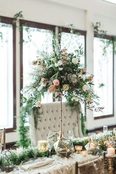 tall elegant centerpiece - photo by Samantha Jay Photography http://ruffledblog.com/enchanted-garden-wedding-ideas