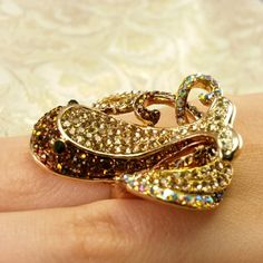 Gorgeous Whale Ring This gorgeous little whale ring is made with champagne and brown Austrian crystal in goldtone size 6 Jewelry Rings