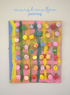 Children collaborate to make a painting from marshmallows.