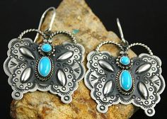 Herman Smith Sleeping Beauty Turquoise Butterfly Design Ingot Dangle Earrings | eBay Navajo artist Herman Smith has created these whimsical earrings out of ingot sterling silver and natural Sleeping Beauty sky blue turquoise. The butterfly design is uniquely his, as it is designed with Herman's home made stamps with reposse designs on the wings and hand braided wire for the antennae. $195