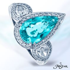 Style 1389 Platinum diamond ring featuring an exquisite 2.26ct pear-shaped paraiba embraced by pear-shape diamonds and edged in pave.