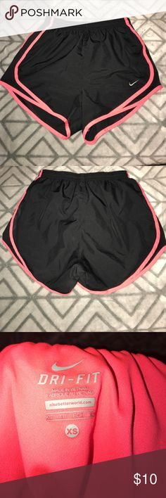 Nike Dri-Fit shorts Pink and black Nike shorts size XS but they are super stretchy and would fit a medium. LIKE NEW only worn a few times! Nike Shorts