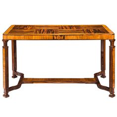 Eric Chambert: A Pewter Inlaid Macassar and Walnut Center Table | From a unique collection of antique and modern center tables at https://www.1stdibs.com/furniture/tables/center-tables/