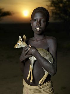Lovely young boy with his pet - photography by Ken herman