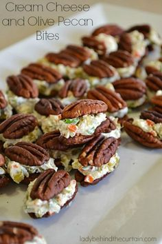 Cheese and Olive Pecan Bites A twist on the popular cheese ball. These Cream Cheese and Olive Pecan Bites recipe can be made into a small cheese ball but I love the presentation of thA twist on the popular cheese ball. These Cream Cheese and Olive Pecan Finger Food Appetizers, Yummy Appetizers, Appetizers For Party, Appetizer Recipes, Snack Recipes, Cooking Recipes, Bridal Shower Appetizers, One Bite Appetizers, Finger Desserts