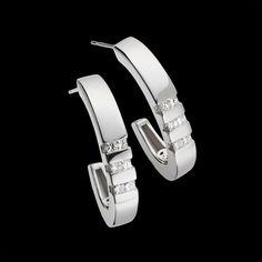 """""""Devotion Diamond Hoop Earrings"""" - 14-karat white gold hoop earrings with twelve diamonds, 0.67 total carat weight."""