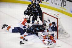 San Jose Sharks forward Joonas Donskoi crashes the net to score a first period goal (Nov. 5, 2015).