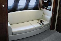 Most master staterooms in this class have a love seat under the port lights, but the 610 Sundancer has a full sofa