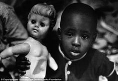Innocent: Gordon Park pictured the Fontenelle children playing in the miserable conditions both inside and outside their New York home
