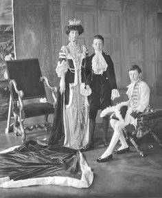 Consuelo, Duchess of Marlborough, née Vanderbilt (1877–1964), with her two sons John Albert Edward William Spencer-Churchill, later the 10th Duke of Marlborough (1897–1972), and Lord Ivor Charles Spencer-Churchill (1898–1956), dressed for the coronation of King George V in June 1911. Although the Duchess had been separated from her husband since 1906, she was still required to attend the ceremony as one of the most important peeresses of realm. Her sons acted as pages to the King.
