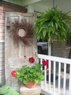 I have an old door and I would love to decorate it with the exact wreath and geraniums! I LOVE the fern also.