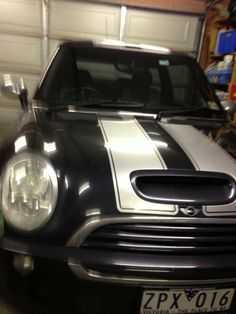 This is my 2006 Cooper S JCW - not sure if the stripes are original or retrofit - mines a manual. Think the stripes are Clubman style.