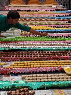 Besan burfi, little fudgy sweets made of besan flour, ghee, sugar, cardamom and pistachios-eaten to celebrate Diwali in India. Photo by Rajesh Kumar. National Geographic Travel, Street Vendor, Let's Have Fun, Indian Sweets, Festival Lights, India Travel, International Recipes, Incredible India, Indian Food Recipes