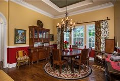 Traditional Dining Room with High ceiling, Crown molding, Carpet, Paint1, Chair rail, Hardwood floors, Chandelier